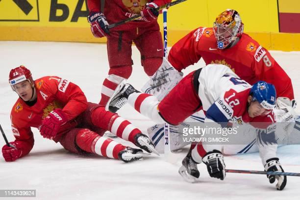 Russias forward Evgeni Malkin vies with Czech Republics forward Dominik Simon next to Russias goalkeeper Andrei Vasilevski during the IIHF Men's Ice...