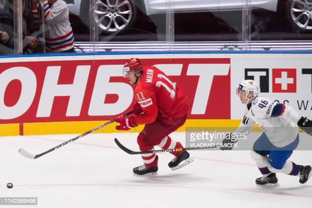 Russia's forward Evgeni Malkin vies with Norway's forward Mathis Olimb during the IIHF Men's Ice Hockey World Championships Group B match between...