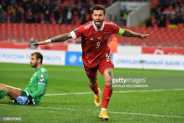 Russia's forward Fedor Smolov celebrates after scoring the opening goal during the FIFA World Cup Qatar 2022 qualification football match between...