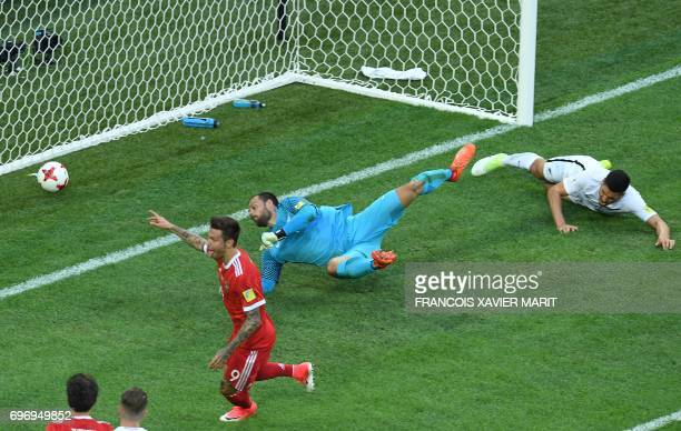 TOPSHOT Russia's forward Fedor Smolov celebrates as he scores the team's second goal during the 2017 Confederations Cup group A football match...