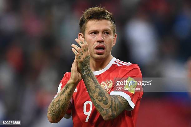TOPSHOT Russia's forward Fedor Smolov reacts as he acknowledges the fans after Russia lost 21 in the 2017 Confederations Cup group A football match...