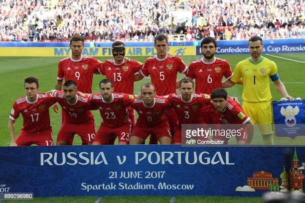 Russia's forward Fedor Smolov Russia's defender Fedor Kudryashov Russia's defender Viktor Vasin Russia's defender Georgiy Dzhikiya Russia's...