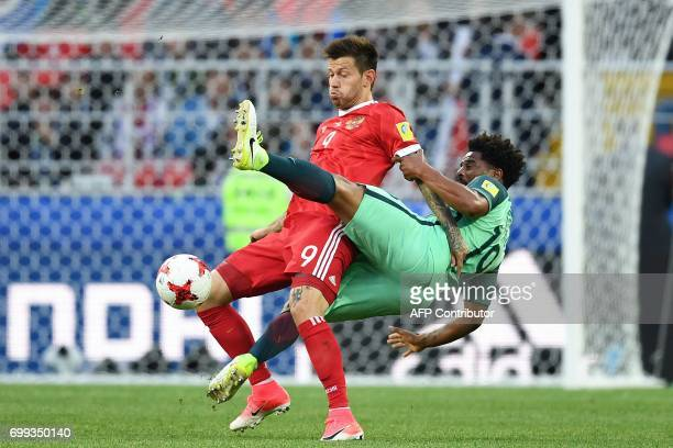 TOPSHOT Russia's forward Fedor Smolov vies with Portugal's defender Eliseu during the 2017 Confederations Cup group A football match between Russia...