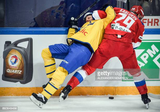 Russia's forward Ilya Kablukov vies with Sweden's forward Linus Omark during the Channel One Cup of the Euro Hockey Tour ice hockey match between...