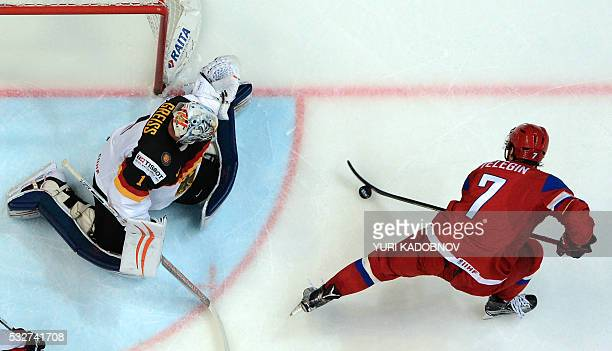 Russia's forward Ivan Telegin attacks Germany's goalie Thomas Greiss during the quarterfinal game Russia vs Germany at the 2016 IIHF Ice Hockey World...
