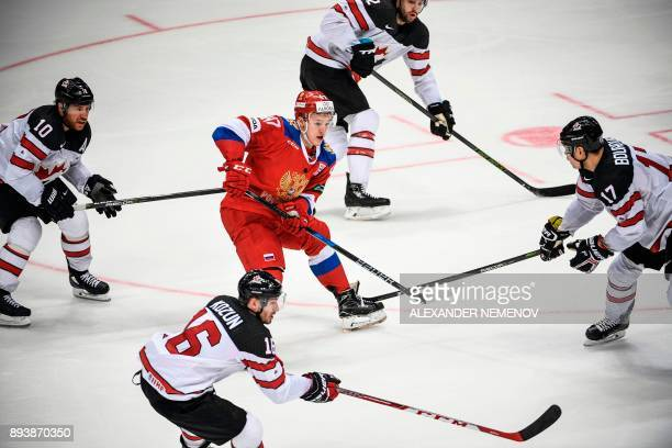 Russia's forward Kirill Kaprizov vies with Canada's players during the Channel One Cup of the Euro Hockey Tour ice hockey match between Canada and...