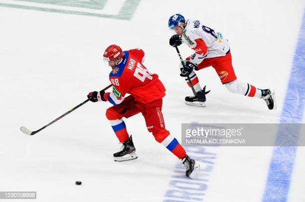 Russia's forward Maxim Mamin vies before scoring with Czech Republic's Dominik Masin during the Channel One Cup of the Euro Hockey Tour ice hockey...
