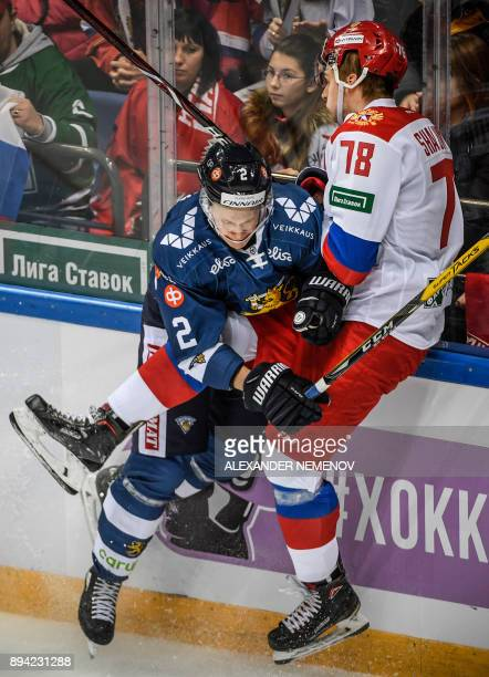Russia's forward Maxim Shalunov fights for the puck with Finland's defender Jyrki Jokipakka during the Channel One Cup of the Euro Hockey Tour ice...