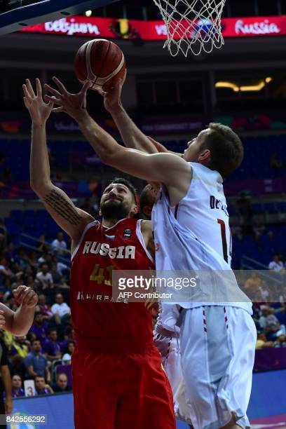 Russia's forward Nikita Kurbanov vies with Belgium's Maxime de Zeeuw during the FIBA Eurobasket 2017 basketball match between Belgium and Russia at...