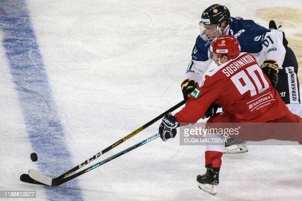 Russia's forward Nikita Soshnikov fights for the puck with with Finland's forward Juho Lammikko during the Channel One Cup of the Euro Hockey Tour...