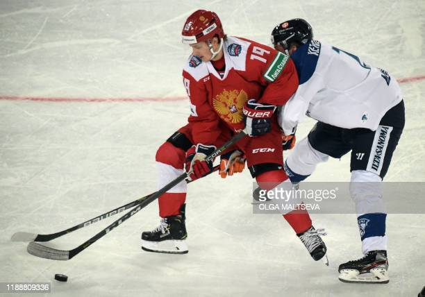 Russia's forward Vladimir E Tkachyov fights for the ball with Finland's defender Valtteri Kemilainen during the Channel One Cup of the Euro Hockey...