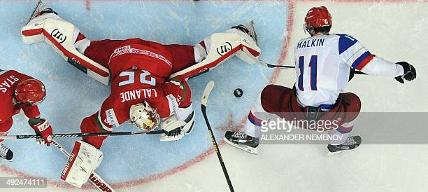Russia's forward Yevgeni Malkin attacks Belerus' goalie Kevin Lalande during a preliminary round group B Ice Hockey game Russia vs Belarus of the...