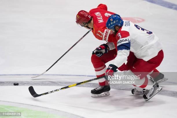 Russia's forward Yevgeni Malkin vies with Czech Republic's defender Radko Gudas during the IIHF Men's Ice Hockey World Championships Group B match...
