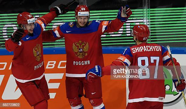 Russia's forwards Artemi Panarin Yevgeni Dadonov and Vadim Shipachyov celebrate a goal during the quarterfinal game Russia vs Germany at the 2016...