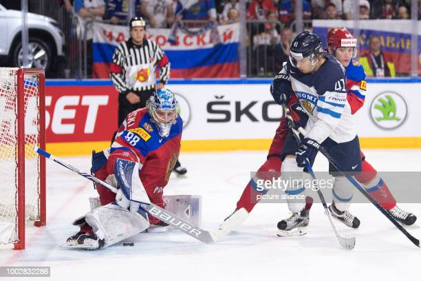 Russia's goalkeeper Andrei Wassilewski stops the puck of Finland's Antti Pihlstrom during the Ice Hockey World Championship thirdplace match between...