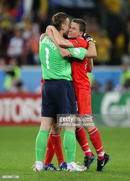 Russia's goalkeeper Igor Akinfeev and Igor Semshov celebrate victory after the final whistle