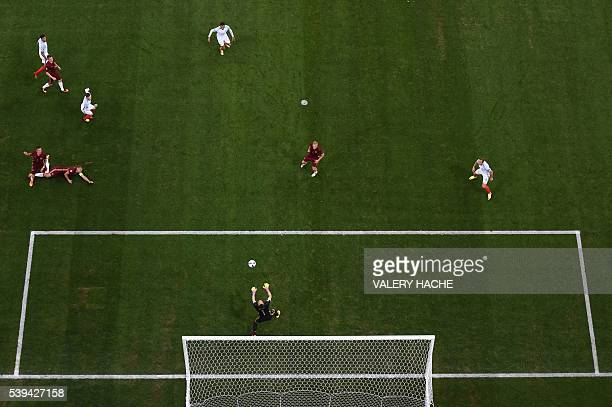 TOPSHOT Russia's goalkeeper Igor Akinfeev catches the ball during the Euro 2016 group B football match between England and Russia at the Stade...