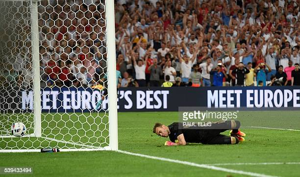 Russia's goalkeeper Igor Akinfeev concedes a goal during the Euro 2016 group B football match between England and Russia at the Stade Velodrome in...