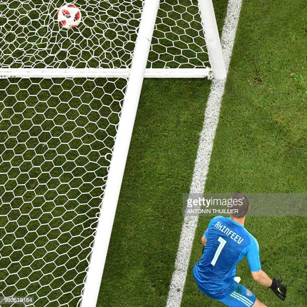 Russia's goalkeeper Igor Akinfeev concedes his team's second goal during the Russia 2018 World Cup quarterfinal football match between Russia and...