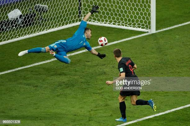 TOPSHOT Russia's goalkeeper Igor Akinfeev concedes the equalizer scored by Croatia's forward Andrej Kramaric during the Russia 2018 World Cup...