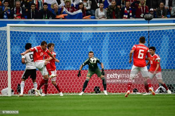 Russia's goalkeeper Igor Akinfeev eyes the ball during the Russia 2018 World Cup Group A football match between Russia and Egypt at the Saint...