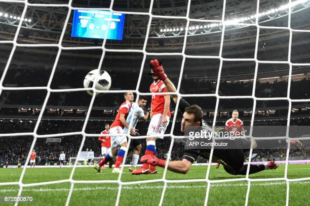 Russia's goalkeeper Igor Akinfeev fails to stop the ball during an international friendly football match between Russia and Argentina at the Luzhniki...