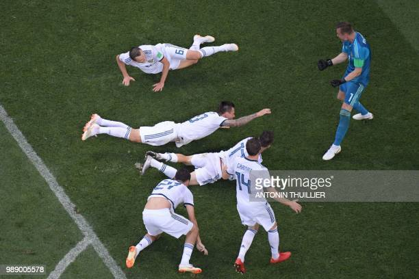 TOPSHOT Russia's goalkeeper Igor Akinfeev reacts as he celebrates with teammates saving the ball in a penalty shootout and winning during the Russia...