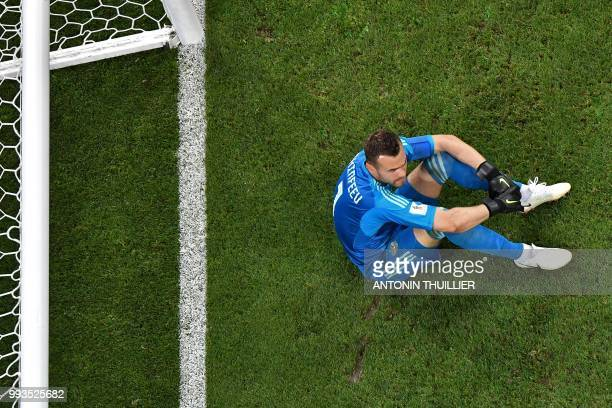 Russia's goalkeeper Igor Akinfeev reacts at the end of the penalty shootouts of the Russia 2018 World Cup quarterfinal football match between Russia...