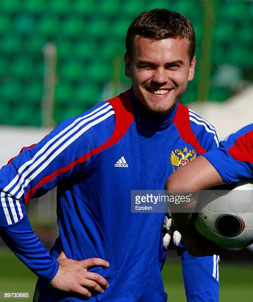 Russia's goalkeeper Igor Akinfeev smiles during a training session ahead of their international friendly match against Argentina at the Eduard...