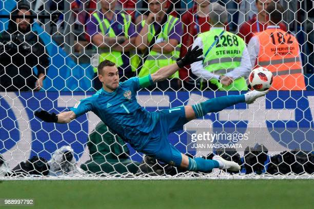 TOPSHOT Russia's goalkeeper Igor Akinfeev stops a shot by Spain's forward Iago Aspas during the penalty shootout of the Russia 2018 World Cup round...