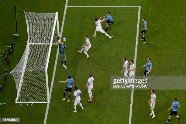 Russia's goalkeeper Igor Akinfeev tips the ball over the bar during the Russia 2018 World Cup Group A football match between Uruguay and Russia at...