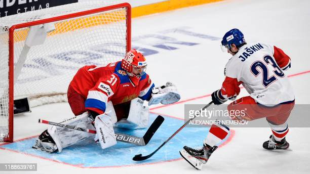 Russia's goalkeeper Ilya Sorokin makes a decisive save as Czech Republic's forward Dmitrij Jaskin fails to score during the Channel One Cup of the...