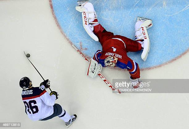 Russia's goalkeeper Semyon Varlamov stops Slovakia's Michal Handzus from scoring during a penalty shootout in the Men's Ice Hockey Group A match...
