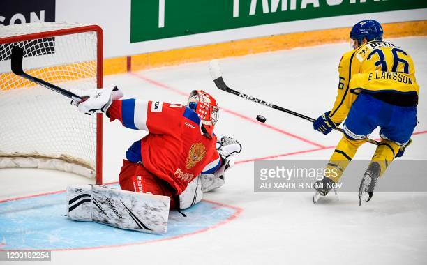 Russia's goaltender Alexander Samonov saves his net during the penalty shootout series, as Sweden's forward Emil Larsson fails to score at the...