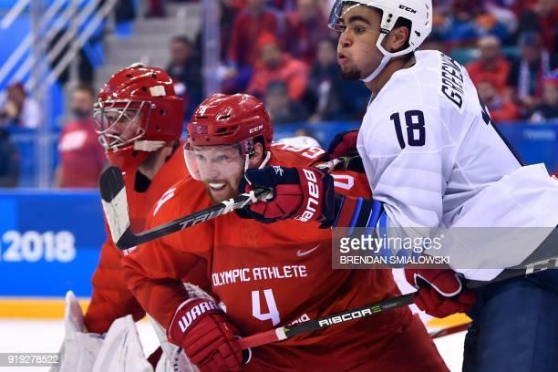 Russia's goaltender Vasili Koshechkin, Russia's Vladislav Gavrikov and US Jordan Greenway eye the puck during the men's ice hockey preliminary round...