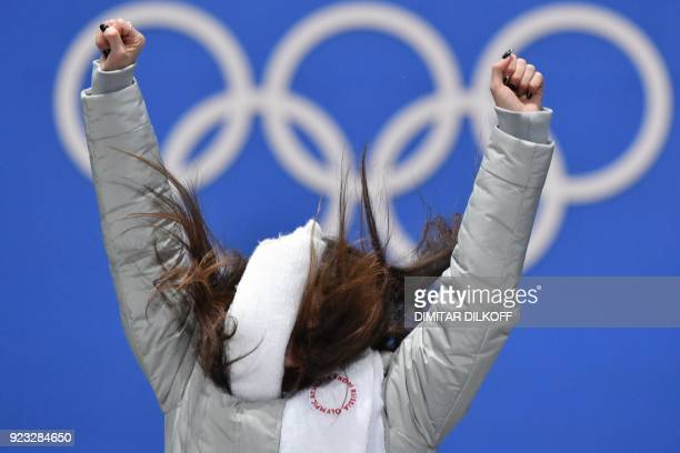 TOPSHOT Russia's gold medallist Alina Zagitova jumps on the podium during the medal ceremony for the figure skating women's singles at the...