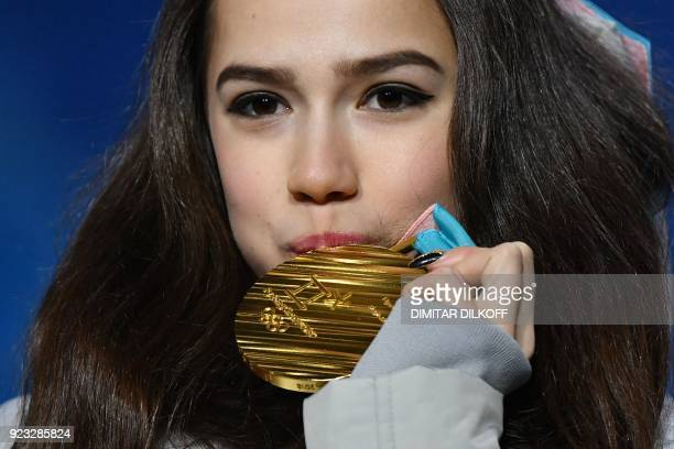 TOPSHOT Russia's gold medallist Alina Zagitova kisses her medal on the podium during the medal ceremony for the figure skating women's singles at the...