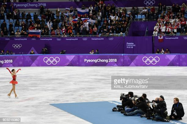 Russia's gold medallist Alina Zagitova poses after the women's single skating free skating of the figure skating event during the Pyeongchang 2018...