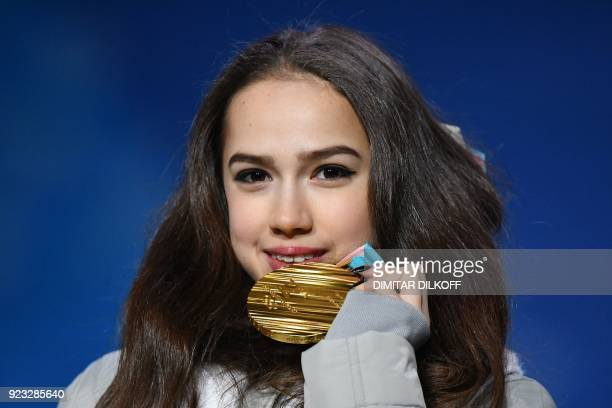 TOPSHOT Russia's gold medallist Alina Zagitova poses on the podium during the medal ceremony for the figure skating women's singles at the...