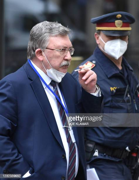 Russia's Governor to the International Atomic Energy Agency , Mikhail Ulyanov, takes a cigarette break outside the 'Grand Hotel Wien' where are...