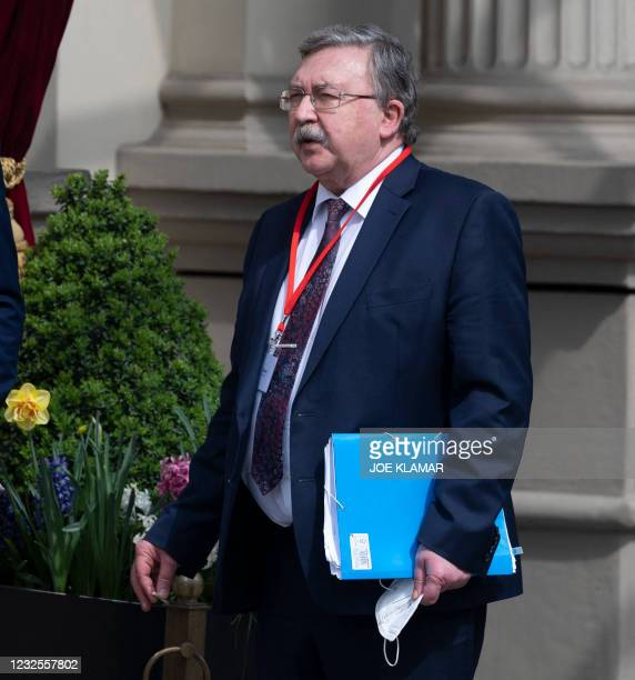 Russia's Governor to the International Atomic Energy Agency , Mikhail Ulyanov stands outside to the 'Grand Hotel Wien' for the closed-door nuclear...