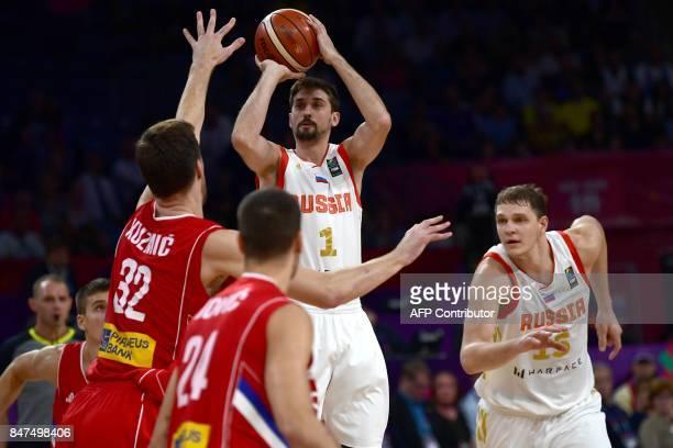 Russia`s guard Aleksei Shved tries to score next to Serbia`s center Ognjen Kuzmic and guard Stefan Jovic during the FIBA Eurobasket 2017 men`s Semi...