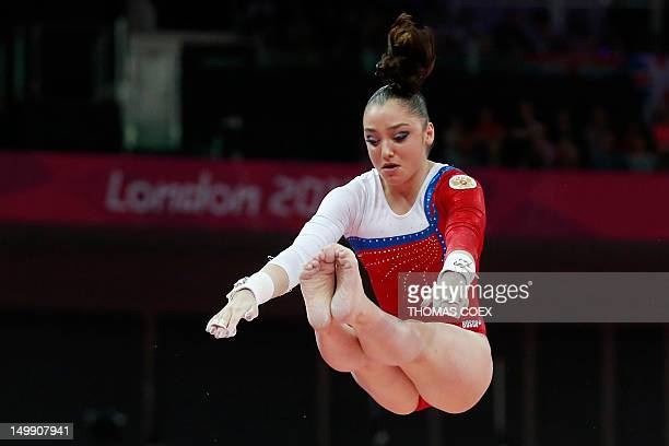 Russia's gymnast Aliya Mustafina performs to win gold in the women's uneven bars of the artistic gymnastics event of the London Olympic Games on...