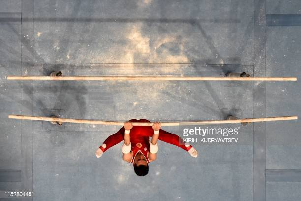 TOPSHOT Russia's gymnast David Belyavskiy competes in the parallel bars event of the men's allaround final of the Artistic Gymnastics at the 2019...