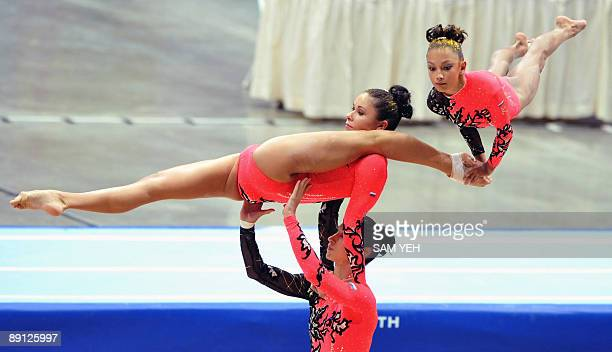 Russia's gymnasts compete in the acrobatic gymnastics women's group competition at the World Games in Kaohsiung on July 21 2009 The World Games drew...