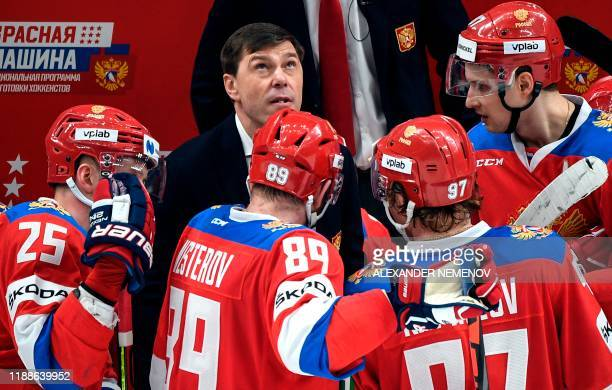 Russia's head coach Alexei Kudashov looks at the scoreboard during the Channel One Cup of the Euro Hockey Tour ice hockey match between Russia and...