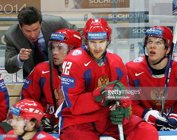 Russia's Head Coach Vyacheslav Bykov talks to players during the IIHF World Ice Hockey Championship bronze medal match between Russia and Sweden at...