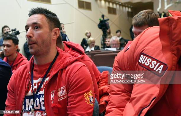 Russia's hockey forward Ilya Kovalchuk takes his seat to attend a meeting of the Russian Olympic Committee in Moscow on December 12 on deciding how...