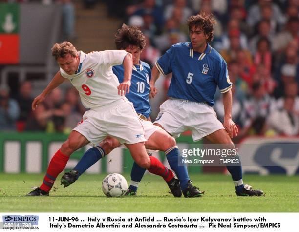 Russia's Igor Kolyvanov battles with Italy's Demetrio Albertini and Alessandro Costacurta