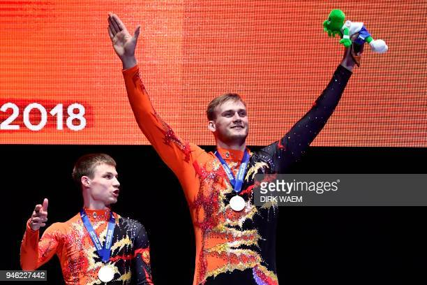 Russia's Igor Mishev and Nikolay Suprunov celebrate on the podium after winning the gold medal on the podium on the second day of the 26th edition of...